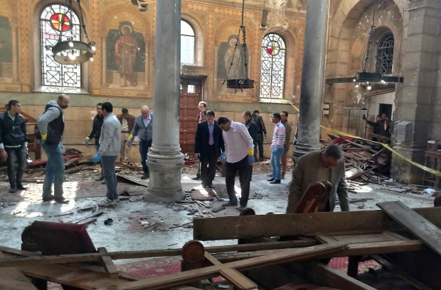 Egyptian security forces examine the scene inside St. Mark Cathedral in central Cairo, following a bombing, Sunday, Dec. 11, 2016. (AP / Omar El-Hady)