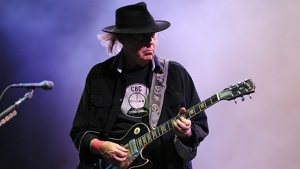 Canadian guitarist Neil Young at the Vieilles Charrues festival on July 20, 2013 in Carhaix-Plouguer, western France. (AFP PHOTO / FRED TANNEAU)