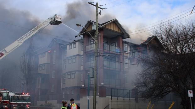 Firefighters battled a massive three-alarm blaze at a Langley, B.C. condo on Sunday, Dec. 11, 2016. (CTV News)