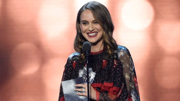 "Natalie Portman accepts the award for best actress for ""Jackie"" at the 22nd annual Critics' Choice Awards at the Barker Hangar on Sunday, Dec. 11, 2016, in Santa Monica, Calif. (Photo by Chris Pizzello/Invision/AP)"