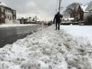 A pedestrian sloshes through snow on the sidewalk in Windsor, Ont., on Monday, Dec. 12, 2016. (Melanie Borrelli / CTV Windsor)