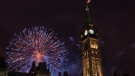 Fireworks explode behind the Peace Tower on Parliament Hill during Canada Day celebrations, in Ottawa on Wed., July 1, 2015. (THE CANADIAN PRESS/Justin Tang)