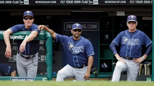 Former Tampa Bay Rays batting coach Derek Shelton, left, bench coach Dave Martinez, center, and manager Joe Maddon watch from the dugout in the ninth inning of the MLB American League baseball game against the Cleveland Indians Saturday, June 1, 2013, in Cleveland. (Mark Duncan/AP Photo)
