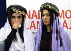 Yazidi women from Iraq, Nadia Murad Basee, right, and Lamiya Aji Bashar pose before receiving the European Union's Sakharov Prize for human rights at the European Parliament in Strasbourg, eastern France, Tuesday Dec. 13, 2016. (AP Photo/Christian Lutz)