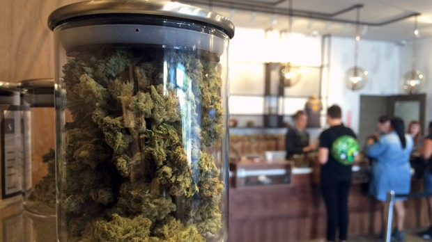 In this April 20, 2016 file photo, customers buy products at the Harvest Medical Marijuana Dispensary in San Francisco, Calif. (AP Photo/Haven Daley, File)