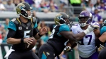 Jacksonville Jaguars quarterback Blake Bortles (5) looks for a receiver as tackle Kelvin Beachum, center, blocks Minnesota Vikings defensive end Everson Griffen (97) during the first half of an NFL football game, Sunday, Dec. 11, 2016, in Jacksonville, Fla. (AP Photo/John Raoux)