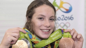 Canada's Penny Oleksiak, from Toronto, holds up her four medals, a gold, silver and two bronze, she won at the 2016 Summer Olympics during a news conference Sunday, August 14, 2016 in Rio de Janeiro, Brazil. Oleksiak is the winner of the Lou Marsh Trophy as Canada's athlete of the year. THE CANADIAN PRESS/Ryan Remiorz