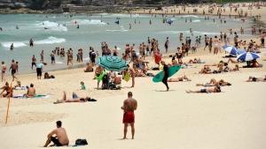In this Tuesday, Dec. 13, 2016 photo, people gather on the sand at Bondi Beach in Sydney, Australia. (Joel Carrett / AAP Image via AP)