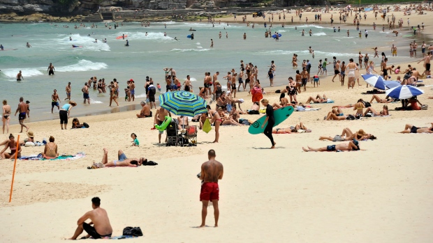 In this Tuesday, Dec. 13, 2016 photo, people gather on the sand at Bondi Beach in Sydney, Australia. (Joel Carrett / AAP Image via AP)