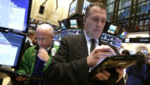 Traders Kevin Walsh, left, and Jonathan Corpina work on the floor of the New York Stock Exchange, Tuesday, Dec. 13, 2016. (AP / Richard Drew)