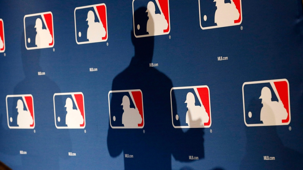 The shadow of MLB Commissioner Rob Manfred