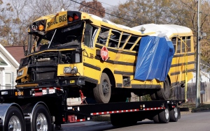 In a Tuesday, Nov. 22, 2016 file photo, a school bus is carried away, in Chattanooga, Tenn, from the site where it crashed on Monday. (AP Photo/Mark Humphrey, File)