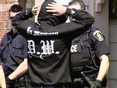 A members of the UN gang is checked for weapons by police in Abbotsford, B.C. May 15th, 2008.