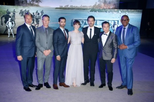 Actors from left, Mads Mikkelsen, Ben Mendelsohn, Riz Ahmed, Felicity Jones, Diego Luna, Donnie Yen and Forest Whitaker pose for photographers upon arrival at the Rogue One: A Star Wars premiere in London, Tuesday, Dec. 13, 2016. (Photo by Joel Ryan/Invision/AP)