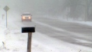 A car makes its way through blowing snow conditions near Conestogo, Ont., on Thursday, Dec. 15, 2016.