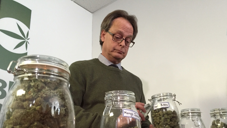 Marc Emery holds a jar of marijuana buds at a Cannabis Culture store on Mont Royal St. in Montreal (CTV Montreal/Cindy Sherwin)