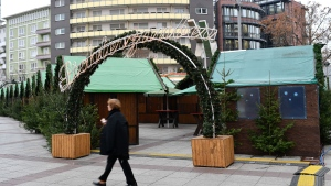 A woman walks past the entrance of the Christmas market in Ludwigshafen, Germany, Friday, Dec. 16, 2016. A 12-year-old Germany-born boy with Iraqi parents is alleged to have tried to set off a nail bomb at the Christmas market on Nov. 26, and again outside city hall on Dec. 5, Focus magazine reported citing security sources. (Uwe Anspach/dpa via AP)