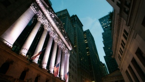 American flags fly in front of the New York Stock Exchange, on  Oct. 8, 2014. (Mark Lennihan / AP)