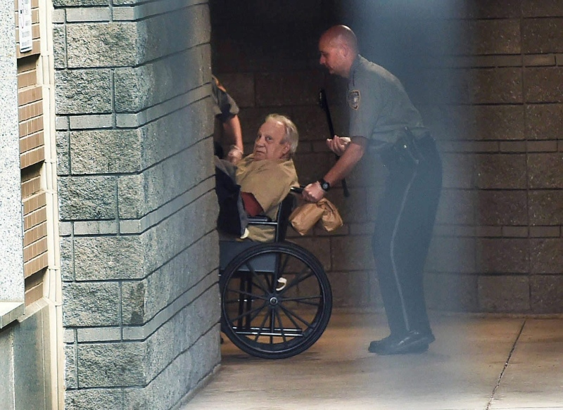 Robert Gentile is brought into the federal courthouse in a wheelchair Monday, April 20, 2015, for a continuation of a hearing in Hartford, Conn. (Cloe Poisson/The Hartford Courant via AP)
