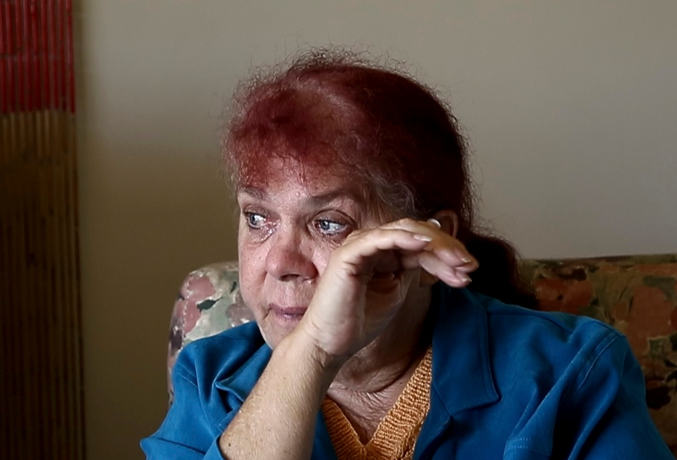 In this Aug. 15, 2016 photo, Thelma Davis cries as she talks about the death of her daughter, Lynette Daley, at her home in Yamba, Australia. (AP Photo/Rob Griffith)
