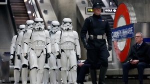 Star Wars enthusiasts dressed as Stormtroopers in Canary Wharf underground station in London, on Dec. 15, 2016. (Matt Alexander / PA via AP)
