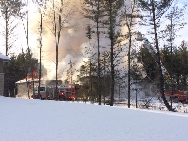 Fire crews battle the blaze at Hedley Way in Kanata on Friday, Dec. 16, 2016. (Jim O'Grady/CTV Ottawa)