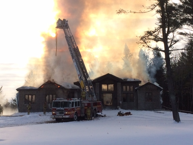 Firefighters battling the blaze on Hedley Way in Kanata say the smoke could be seen from as far away as the 417 and March Rd.  (Jim O'Grady/CTV Ottawa)