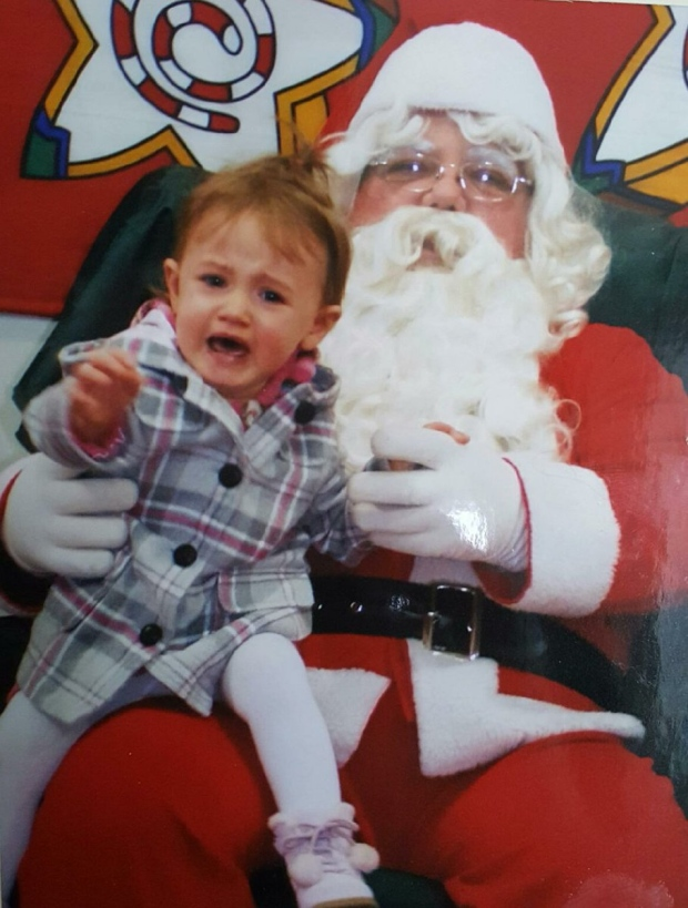 Santa seemed a little too scary for a tot in this photo sent to us by Angie Hallman.