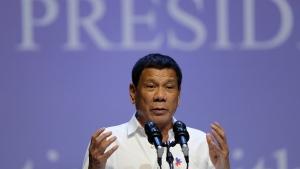 Philippine President Rodrigo Duterte speaks to the Filipino community in Singapore, on Friday, Dec. 16, 2016. (AP Photo/Wong Maye-E)