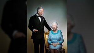 This photograph taken by Nick Knight is a portrait of Queen Elizabeth II and Prince Charles, taken in the White Drawing Room at Windsor Castle, England in May 2016. (AP / Nick Knight)