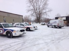 London police, including forensics, is on scene of a homicide in southeast London, Ont, on Sunday, Dec. 18, 2016. (Natalie Quinlan / CTV London)