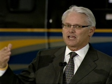 Premier Gordon Campbell reacts to an announcement of $350 million in federal funding for the Evergreen line in Burnaby, B.C., on February 26, 2009.