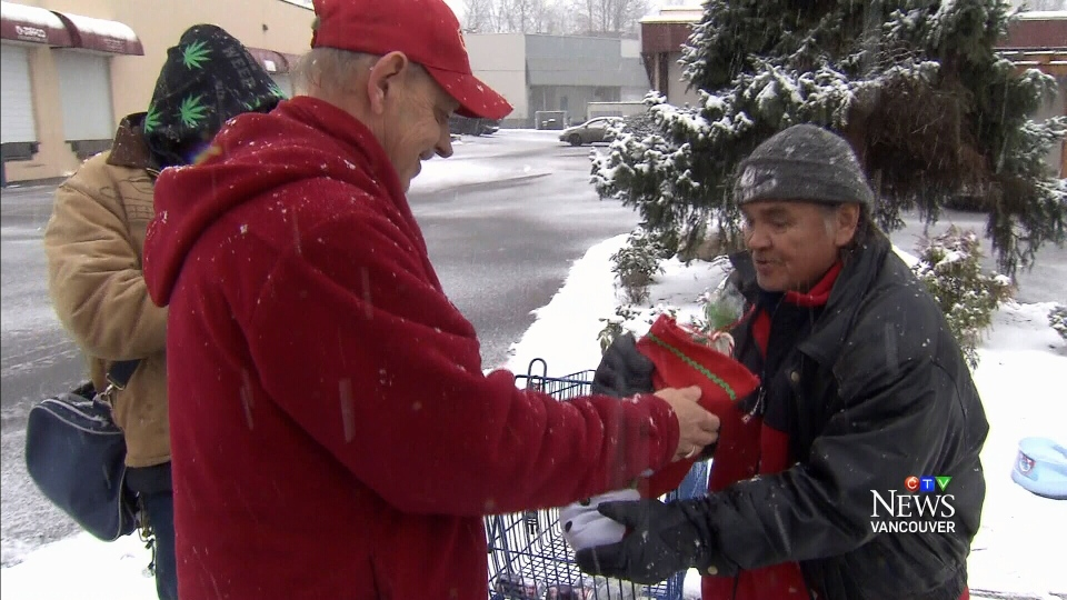 Hank Brennan handed out stockings and gifts cards to the homeless on Sunday.
