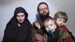 Canadian Joshua Boyle and his American wife Caitlan Coleman are shown with their children in a still from a video posted online. (YouTube)