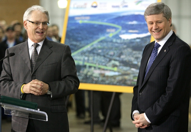 British Columbia Premier Gordon Campbell, left, and Prime Minister Stephen Harper smile after announcing funding for the Evergreen Line rapid transit system in Burnaby, B.C., on Thursday February 26, 2009. (THE CANADIAN PRESS/Darryl Dyck)