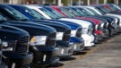 FILE - In this Jan. 5, 2015 file photo, Ram pickup trucks are on display on the lot at Landmark Dodge Chrysler Jeep RAM in Morrow, Ga.(AP Photo/John Bazemore, File)