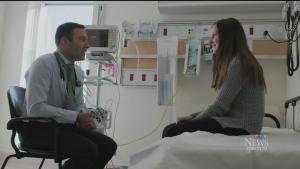 A doctor speaks to a female patient in this file photo.