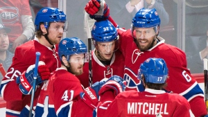 Montreal Canadiens' Paul Byron (41) celebrates with teammates Jeff Petry (26), Brian Flynn (32) Shea Weber (6) and Torrey Mitchell (17) after scoring against the Anaheim Ducks during first period NHL hockey action in Montreal, Tuesday, December 20, 2016. (Graham Hughes/The Canadian Press)