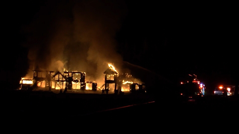 A fire broke out at a luxury home in the Comox Valley Tuesday, reducing it to a smouldering pile of rubble. Dec. 20, 2016. (Courtesy Comox Valley Record)