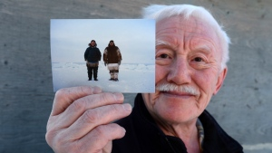 Piita Irniq holds a photograph in Ottawa on Wednesday, Dec. 21, 2016, taken in 1984 of himself and Marius Tungilik while seal hunting 25 miles outside Rankin Inlet. THE CANADIAN PRESS/Sean Kilpatrick