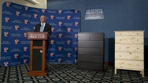 With two Ikea dressers displayed at right, Consumer Product Safety Commission (CPSC) Chairman Elliot Kaye speaks during a news conference at the National Press Club in Washington, Tuesday, June 28, 2016. (AP / Carolyn Kaster)