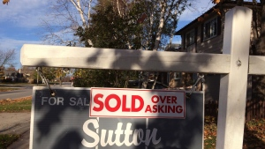 A 'sold over asking' sign is shown on a real estate sign in Oakville, Ont. on Thursday, Nov.17, 2016. (Richard Buchan / THE CANADIAN PRESS)