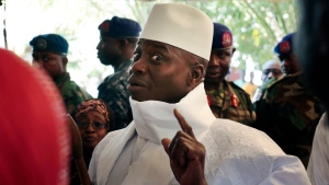 Gambia's president Yahya Jammeh shows his inked finger before voting in Banjul, Gambia on Thursday, Dec. 1, 2016. (AP / Jerome Delay)