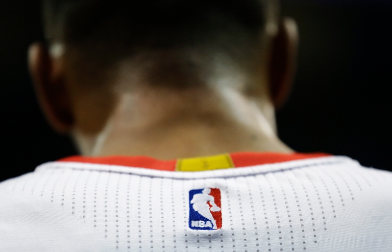 In this April 7, 2015 file photo, an NBA logo is displayed on the back of a player's jersey during an NBA basketball game, in Atlanta. (AP Photo/David Goldman)