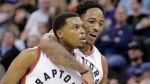 Toronto Raptors' Kyle Lowry (7) celebrates with teammate DeMar DeRozan (10) after scoring in the second half during an NBA basketball game against the Utah Jazz Friday, Dec. 23, 2016, in Salt Lake City. The Raptors won 104-98. (AP Photo/Rick Bowmer)