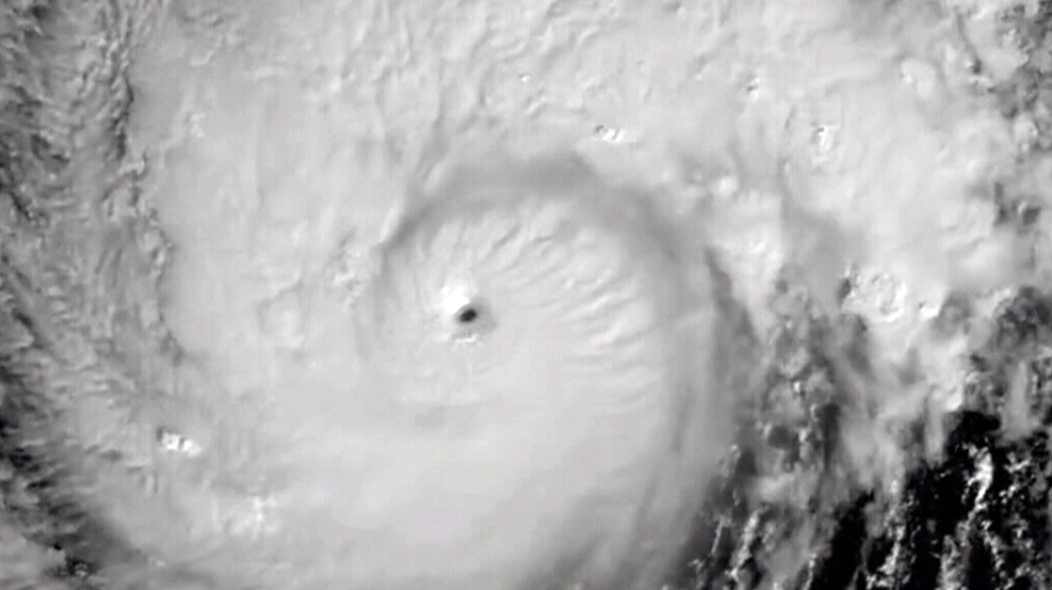 Satellite imagery from the US government on December 24 showed the swirling Super Typhoon Nock-ten approaching the eastern coastlines of the Philippines.
