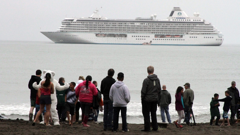 In this Aug. 21, 2016, file photo people prepare to take a polar plunge in the Bering Sea in front of the luxury cruise ship Crystal Serenity, which anchored just outside Nome, Alaska. (Mark Thiessen, File/AP Photo)