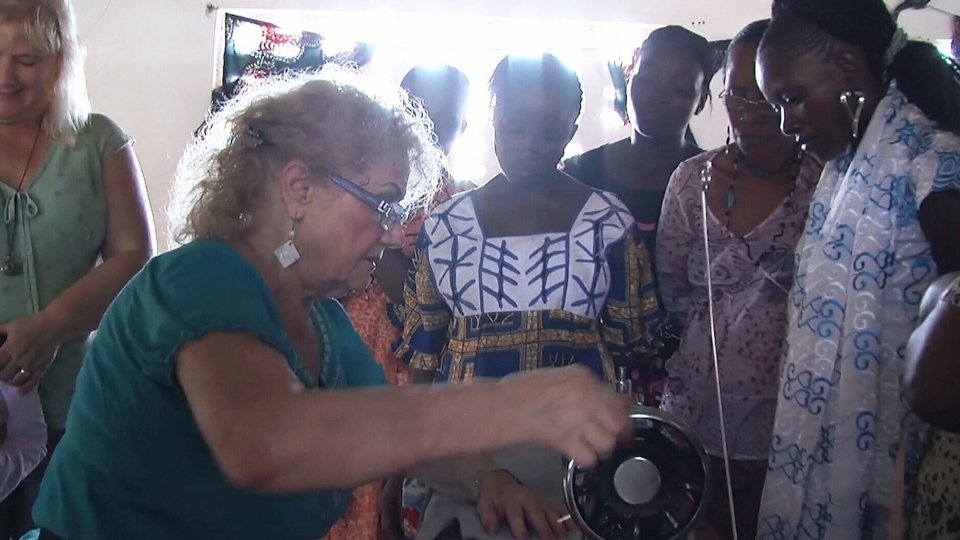 Sylvia Rempel teaches participants how to use a sewing machine in one of her Sewing Seeds International classes.