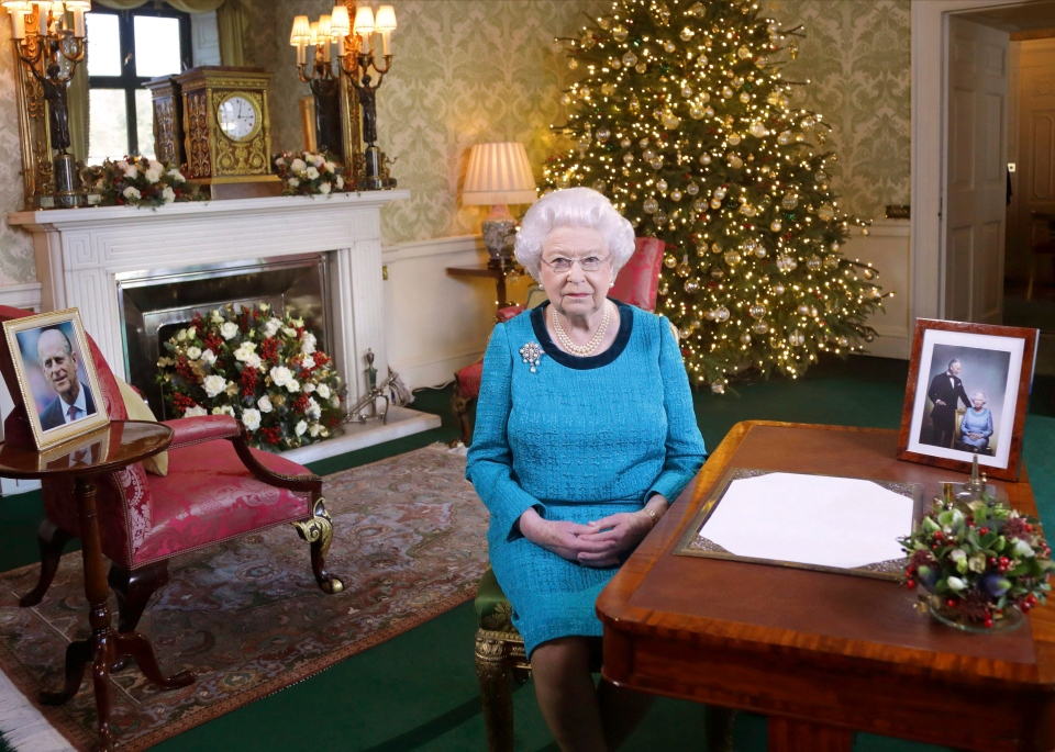 In this photo released early Sunday Dec. 25, 2016, Queen Elizabeth II poses for a photo, sitting at a desk in the Regency Room of Buckingham Palace in London, after recording her traditional Christmas Day broadcast to the Commonwealth. (Yui Mok / Pool via AP)