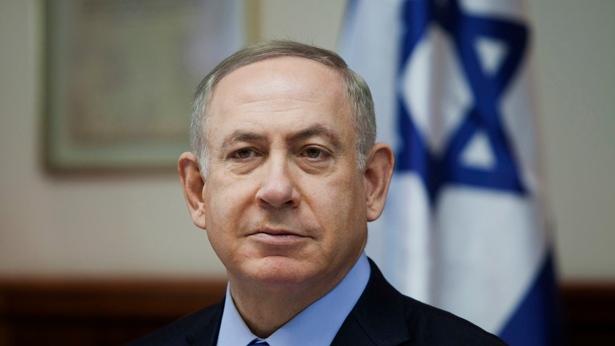 Israeli Prime Minister Benjamin Netanyahu attends a weekly cabinet meeting in Jerusalem, Sunday, Dec. 25, 2016. (Dan Balilty/Pool photo via AP)